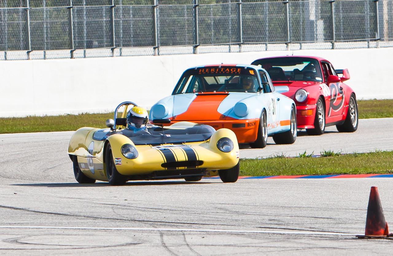 Two Porsches chase Lotus 23B