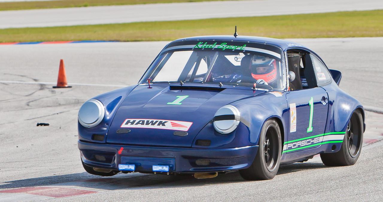 Cody Ellsworth lifts right font wheel of 1973 Porsche 911 3.0