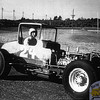 """Here's a great color shot from Hudson of New England Auto Racing Hall of Famer, the late Jerry Dolliver. From his HOF biography; """"Jerry Dolliver was never known to the national racing community, but he was one of the shiniest gems ever to come out of the Merrimack Valley and certainly one of the most admired. Jerry was born in 1929 in Melrose, Mass. and as a young man set up automotive shop in Kingston, N.H.  He never ventured far.  Instead, he was always there, steady as the morning sun, always warming customers with a smile.  His Sunoco pumps were the epicenter of town talk for decades.<br /> Jerry's racing was the same: nearby, competent, reliable, fan-friendly.  It all started in a hulking wire-wheeled ice machine in 1949, and just five years later, he defeated Ollie Silva and Oscar Ridlon's finest to become Champion at The Pines Speedway. Eight championships were to follow, along with scores of victories at more than 15 New England venues.  There were cutdowns, modifieds, supermodifieds, sprinters, and midgets. Probably Jerry's most telling accomplishment, though, was his unparalled success with one engine - a flathead built by Hall of Famer Bill Welch.  Ever so smoothly, Jerry coaxed that old-time power plant along to over 100 feature wins, right when the vastly lighter and more powerful overheads were sweeping the pit area."""" (Photo Courtesy R.A. Silvia Archives)."""