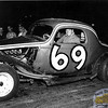 """First on the slate this week we have a coupe-era shot of New England Auto Racing Hall of Fame member, the late Mario """"Fats"""" Caruso. An excerpt from his HOF biography; Mario """"Fats"""" Caruso began racing in 1949, with his brothers Tony and Funzie, and close friends Al Mattress and Vince Abdella. The team's first car was a Class B Ford sedan. After cutting his racing teeth with this car, Frank White offered Caruso a ride in his Circle 2, a cut down, which he drove to many feature wins, and eventually the NEARA championship. Fats had made a name for himself locally, at tracks like Seekonk, Thompson, Westboro, and Norwood. When he got the ride in the #69 coupe, sponsored by Worcester Sand and Gravel, his career really started to take-off. He began competing at tracks like Old Bridge and Trenton in New Jersey, Utica-Rome and Oswego in New York and Dover and Hudson in New Hampshire. Caruso was a consistent top five finisher, and a regular threat to win wherever he competed. (Photo Courtesy R.A. Silvia)."""