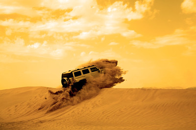 One of my favorites from when I was in Jeddah, Saudi Arabia. The Hummer took a beating when it first hit the dune and then upon landing on the other side but it made this shot possible. I actually had no idea he was going to go over the top but managed to spin around in time and snap it.