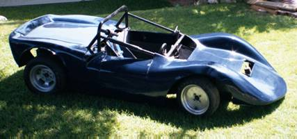* Steel space frame chassis<br />     * Suspension<br />           Front: tube unequal length A arms with coil over<br />           Rear: top link, dual trailing rods, lower A arm, coil over <br />     * Steering: rack and pinion, source unknown<br />     * quick release steering wheel<br />     * Brakes - front: disks (Spitfire?); rear: drums (Imp?)<br />     * Right hand seating position