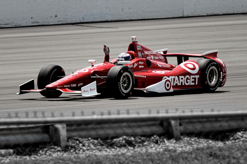 New Zealander Scott Dixon, winner of the Pocono IndyCar 400, waves to the crowd from his Honda-powered Indy car.