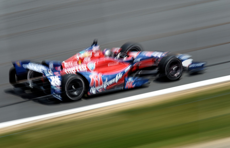 Hometown favorite, Marco Andretti, zips by in a 220 mph blur! (captured with 1/30th sec shutter speed while panning)