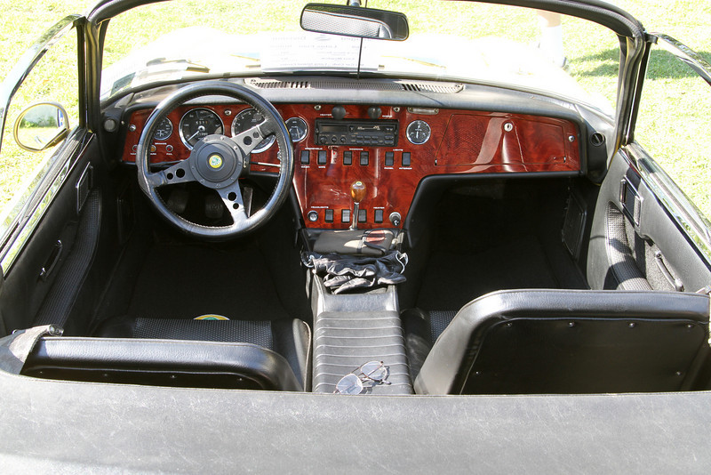 Lotus Elan interior. Look at an enlargement of the photo and note how big the gloves and eyeglasses are in relation to the rest of the interior. These items would be lost in a photo of a normal interior.