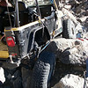 This was how he drove it off the trail. His own winch attached to the axle via a snatchblock held into position via a tree saver, and another tree saver wrapped around the axle. and a ratchet strap also attached to the roll cage.