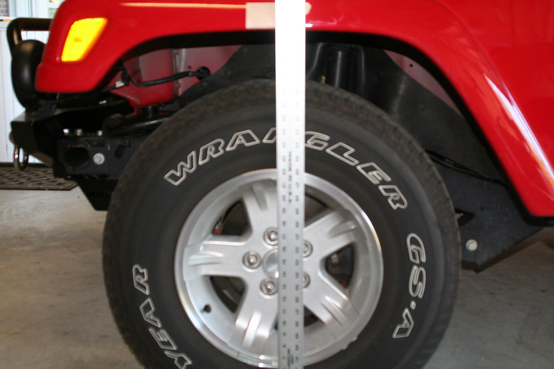 Marking factory axle center location prior to lift in order to properly relocate with adjustable control arms.