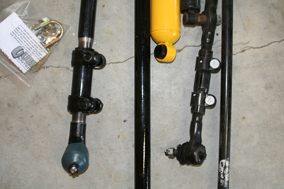 Currie adjustable drag link (left) vs stock.