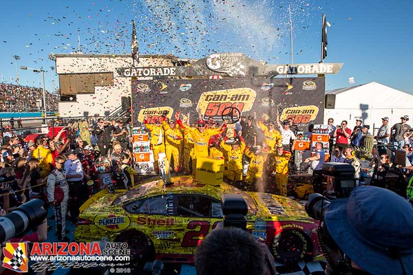 Joey Logano takes the Checkered Flag at the 2016 NASCAR Sprint Cup Can-Am 500 at PIR