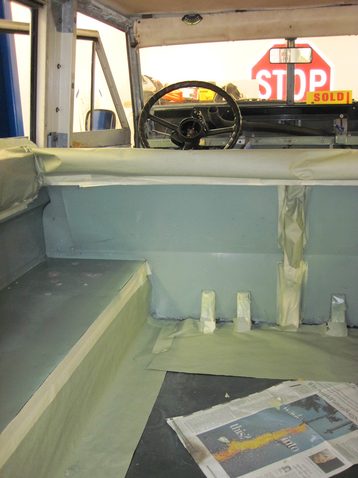 Masking off rear prior to spraying.
