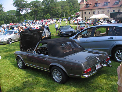 Mercedes-Benz 280SL with a V8 conversion (is that why he has an SLR 280 license plate?)