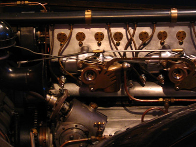 Bugatti Type 30 engine. Note the hands on the throttle linkage.