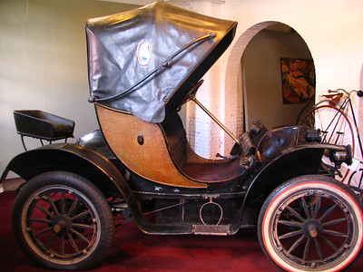 Bailey Electric (1908). Built in Amesbury, MA! Purchased new by the Andersons and became a favorite of Isabel herself. It ran on 13 6-volt batteries and had a range of 50 miles. Because electric cars didn't produce crude and offensive noises and smoke, they were a favorite among women. The Bailey company of Amesbury also built carriages and were among the pioneers of electric carriage building.
