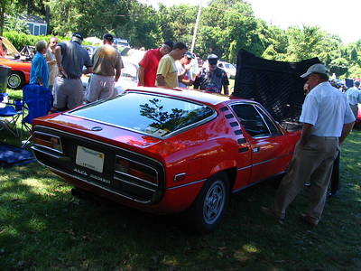 Alfa Romeo Montreal. This is a pretty rare car and an unusual one for Alfa Romeo to produce in the 1970s. It uses a 2.6-liter V8 (GTVs of the time used 2.0-liter four cylinders) and is a rather large car by Italian standards. The styling is by Marcello Gandini at Bertone, who is also responsible for several notable Italian cars.