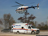 Nassau County Police helicopter leaves the Oyster Bay LIRR station parking lot carrying a patient on a medevac flight.