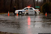 Old Brookville Police close a road following heavy rain storms.