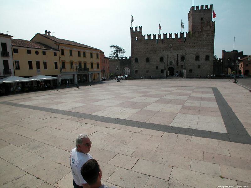 Lower castle in Marostica looking across chessboard piazza. The city walls climb from the lower to the upper castles, enclosing the entire hillside.