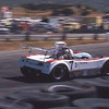 June Sprints, July, 1974, DSR LeGrand Mk18 chassis #0001. [Richard Pryor's] Brother Bill built this car up from a pickup full of a tub and misc. pieces that we picked up at Red LeGrand's shop in San Fernando. Lots of development work and some superb driving by Bill netted a wall full of first place trophies and checkered flags. Turn 9 when the tires had replaced the hay bales...much bouncier when you hit them. Many drivers learned to gauge the distance to perfection and came off the track to impound with a black rubber streak on their car's rear quarter panel.