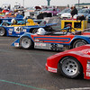 B Modified Nationals, year?<br /> <br /> Nearest to furthest:<br /> Red #22 - Kenneth Baker, 2004 Knight DS-R<br /> Blue/Red #36 - Bob Sonntag, 1979 LeGrand Mk25<br /> Blue #46 - Jose Gonzalez, 1979 LeGrand Mk18 DSR<br /> Blue #49 - Clemmens Burger, 1976 LeGrand Mk18 (barely visible)<br /> Blue #66/166 - Jeff & Evan Brauch, 1998 Omni-Fab Cheetah SR-1