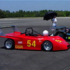 "Craig Farr says, this photo ""was taken at a Solo I event at Skelly Field near Enterprise, Alabama in 2003. The red car is Terry Green's LeGRand Mk18. The black car is Tom Haugh's OMS. The silver car is Richard Felis' exceptional LeGrand (Chassis #3). Richard mashed it up a bit in a Hillclimb and is rebuilding the front end."" [quoted dated 12/23/2008]"