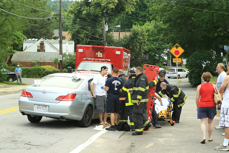 Leominster Firefighters tend to a victim of a two car collision at the intersection of Blossom and Merriam Ave<br /> <br /> Photo Scott LaPrade