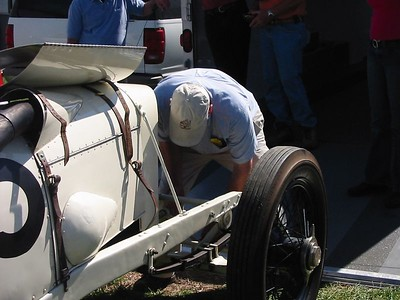 Benedict Special. The owner is working on starting the 300 cu in engine using the hand crank.