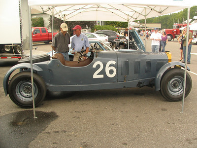 Bu-Merc. This is one of the earliest and historic American racecars. The car is a 1939 Buick Century chassis, Buick V8 engine, and the Mercedes SSK body. It was conceived and raced by Briggs Cunningham before World War II, therefore pre-dating even the SCCA, Watkins Glen, Ferrari, and just about everyone else in modern American road racing. In the first Watkins Glen race in 1948, Cunningham drove this car to 2nd place. It is one of the genuine old warhorses of American road racing.
