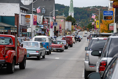 I've swung around to look the other way. Ray is at the top of the hill. Closer to the center of town, each car is being announced by a guy in the back of a pickup truck.