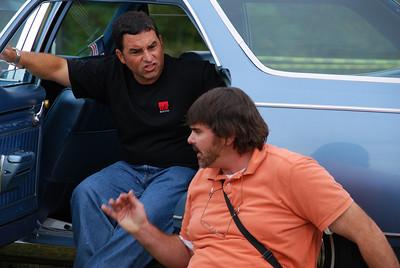 Car talk? Politics? I was too far away to hear it.