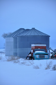Old farm truck with grain bins, near Idaho Falls, ID. 2.09