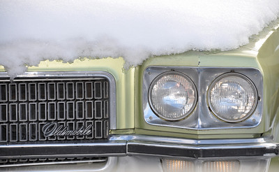Snow covered chartreuse Oldsmobile.  Idaho Falls, ID 1.10