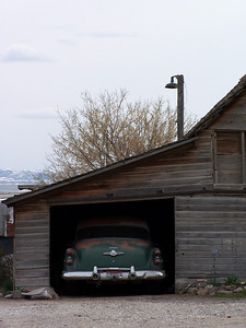 Old Car parked in an old outbuilding in Ammon, ID