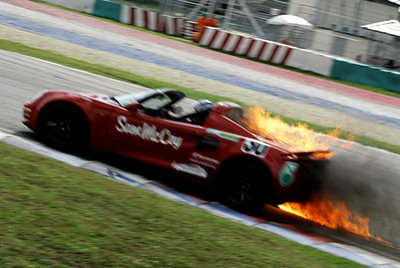 Malaysia - Sepang. Despite the dramatic photo the fire was from a failed fuel pressure regulator and did not cause any damage.