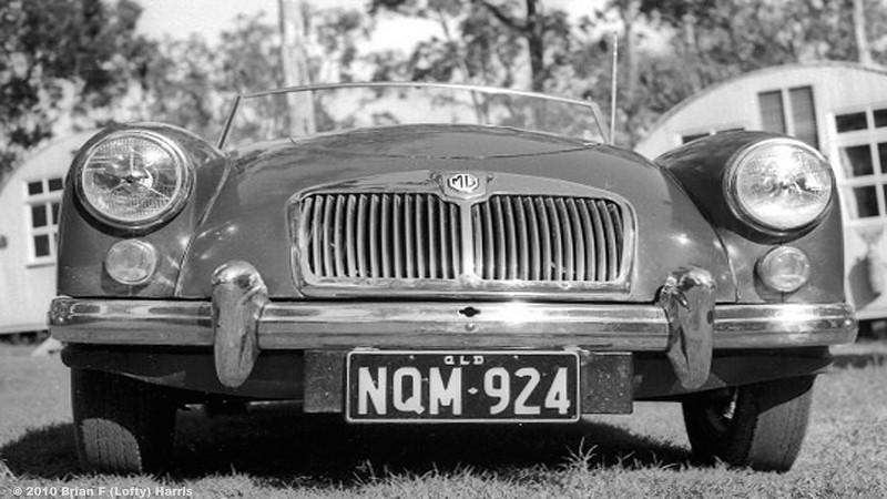 The Lofty Harris 'British Racing Green' MGA sports car next to his hut in Wacol Army Camp Qld.1964