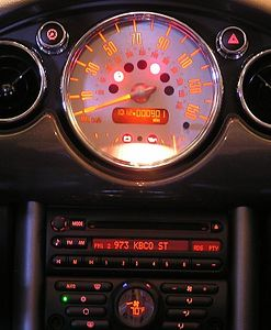 Center mounted speedometer, just like in the classic Mini. The stereo is below the speedo. Below that, in the shape of the MINI nameplate, is the auto heat & A/C control.