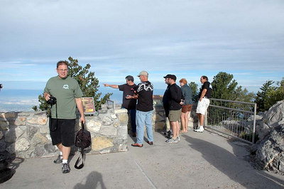 Andy and others enjoying the warm morning sun and the cool (cold) temperature at the top of the Sandias.