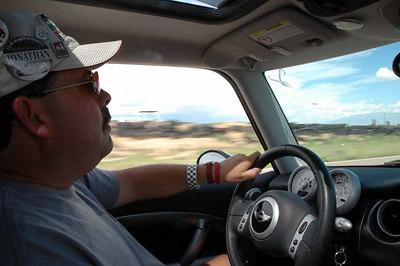 Jonathan at the wheel of his Pure Silver MINI.