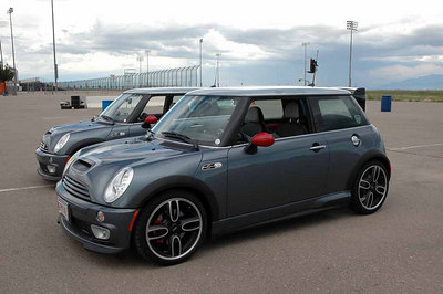 "A couple of the brand-new ""MINI Cooper S with the John Cooper Works GP Kit,"" or more commonly known as the Works GP."