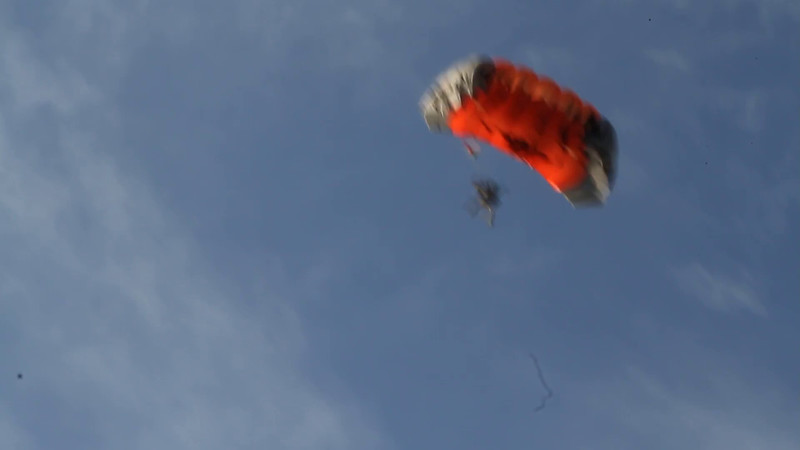 Among the first-morning events was this exciting arrival of a parachuting team to a unique destination!