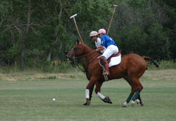 The female player (pink helmet) chasing the ball.
