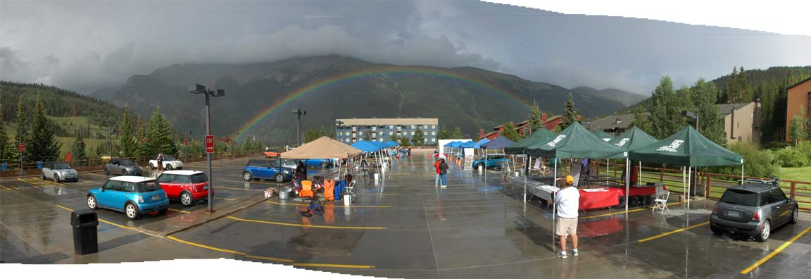 "A panoramic photo of the rainbow, made by ""stitching"" several separate photos together. Not enough time to get the tripod."