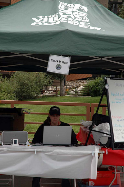 Shannon at the check-in tent, making sure everything is just right.