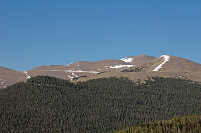A view of the Mt Evans area from the east, near the entrance. The peak is not in view (too close). Notice the Mt Evans road above the tree line.