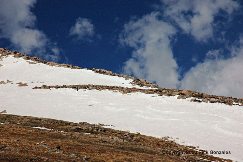 A couple of skiers enjoying the short lift lines and small crowds (hike up, ski down).