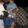 img_0212 - How many track officials & a few audience viewers does it take to fix a light problem?  Not sure, but they did it!  We had a couple of electricians watching the race, thank goodness!  And thanks to all that helped!