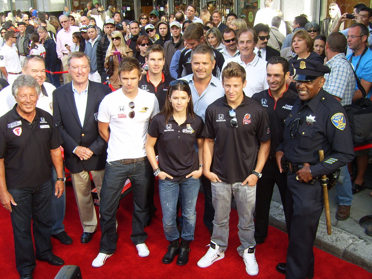 WINNER's GATHERING -- Thirteen Indianapolis 500 victories are represented in this group photo of past and present IndyCar drivers. From left, Mario Andretti, one victory; Al Unser, Jr., two wins; Johnny Rutherford, three; Dan Weldon, one; Will Power; Danica Patrick; Gil DeFerran, one; Marco Andretti; Arie Luyendyk, two; and Helio Castroneves, three.