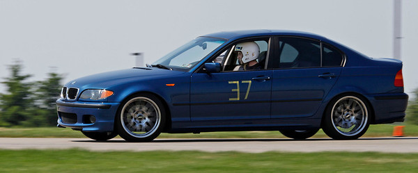 Kyle McKeown was the fastest of five novices. He drove the #37 blue Class B e46 325i to B/C/D 6th place in 50.752 (49.245). A record 32 drivers competed in the opening round of the Michiana BMW CCA autocross season at the Tire Rack on May 19, 2012. (Bradley S. Pines / CONTACT: OneTrackMind.brad@gmail.com)