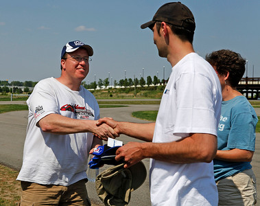Chris Itterly, left, receives a trophy hat from chapter autocross co-chairs Carl Zmijweski and Eve Dolenski. Itterly drove his Class B classic white 1979 e21 323i to first place in B/C/D and 7th overall with a fastest time of 47.184 (46.245). A record 32 drivers competed in the opening round of the Michiana BMW CCA autocross season at the Tire Rack on May 19, 2012. (Bradley S. Pines / CONTACT: OneTrackMind.brad@gmail.com)