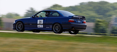 Carl Zmijewski drove his blue #29 e36 M3 to third in Class AA, 4th overall with a fastest lap of 45.666. A record 32 drivers competed in the opening round of the Michiana BMW CCA autocross season at the Tire Rack on May 19, 2012. (Bradley S. Pines / CONTACT: OneTrackMind.brad@gmail.com)