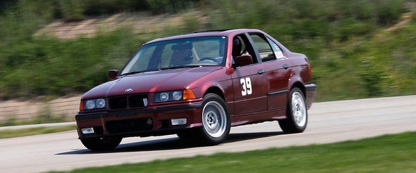 Matt Huizing was fastest in Class C in 49.651 (48.176) in his #39 red e36 sedan. A record 32 drivers competed in the opening round of the Michiana BMW CCA autocross season at the Tire Rack on May 19, 2012. (Bradley S. Pines / CONTACT: OneTrackMind.brad@gmail.com)